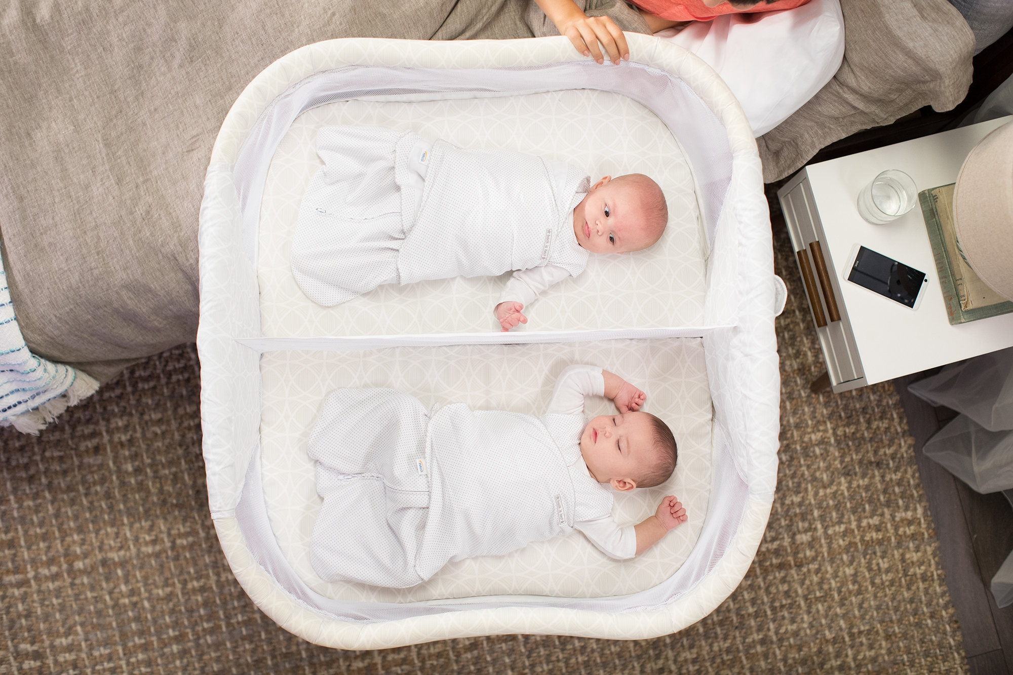 twin babies sleeping in halo bassinest twin sleeper bedside bassinet