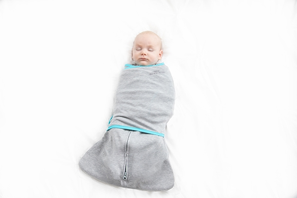sleeping baby wrapped in tech fabric swaddle