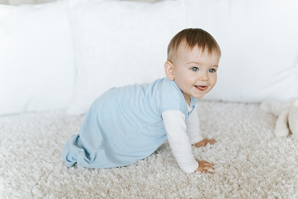 baby crawling in halo sleepsack early walker