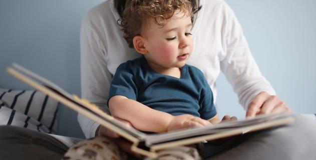 toddler and parent readinga bedtime story