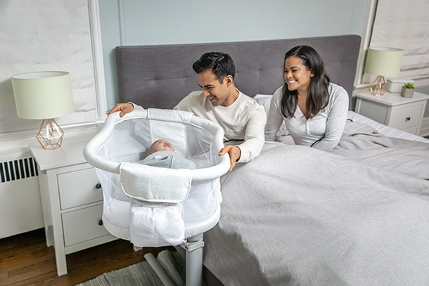 parents in bed swivelling halo bassinest swivel sleeper