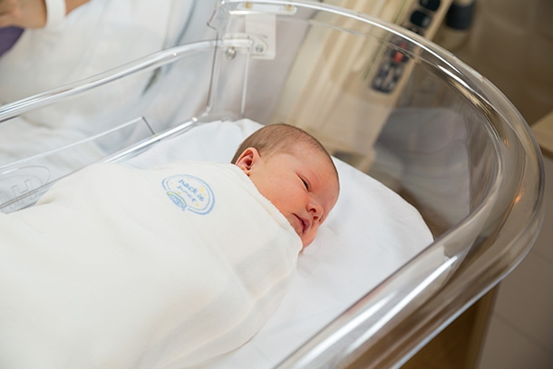 baby sleeping in halo hospital bassinest and hospital sleepsack swaddle