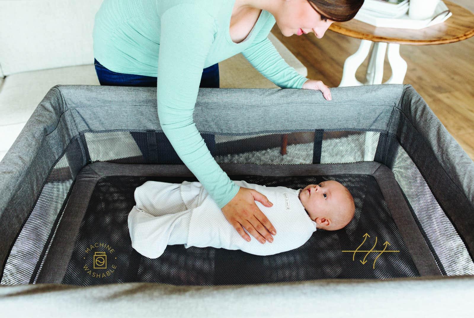 baby sleeping in dreamnest open air sleep system