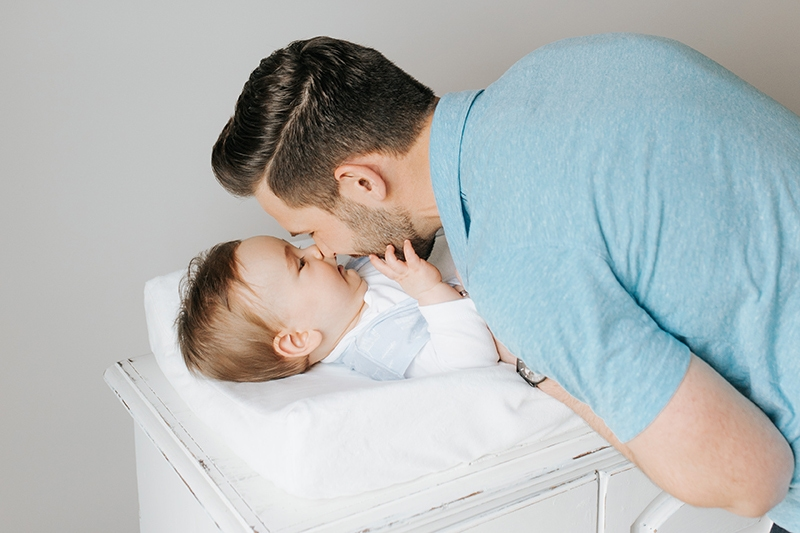 parent touching his nose to babies nose