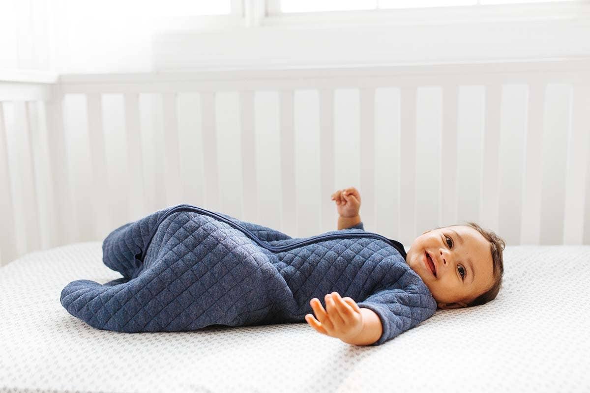 baby in crib in halo easy transition sleepsack