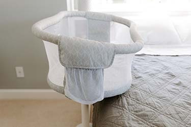 essentia bedside bassinet in bedroom