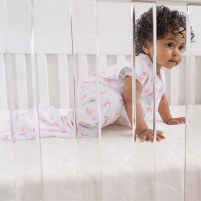 baby in crib on halo firm and breathable crib mattress