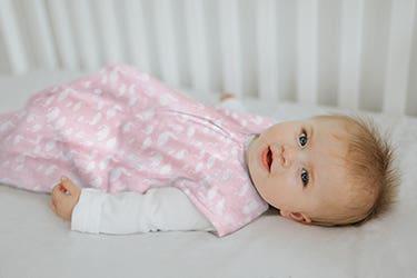 baby in halo sleepsack wearable blanket in micro-fleece fabric