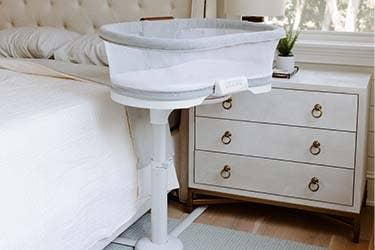 luxe bedside bassinet in bedroom