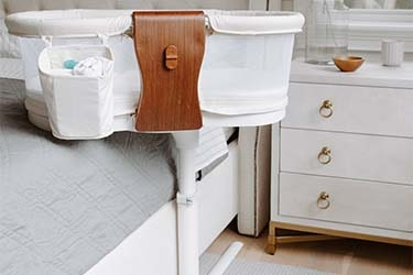 luxe plus bedside bassinet in bedroom