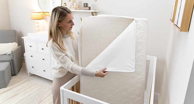 mom removing core from dreameweave breathable crib mattress