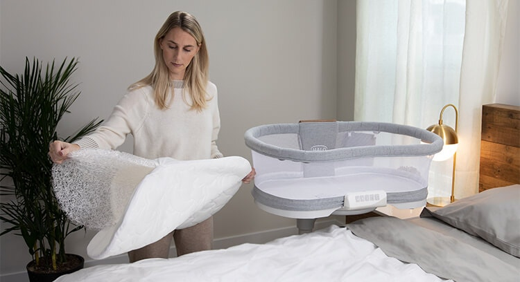 mom removing core from dreameweave bassinest breathable mattress