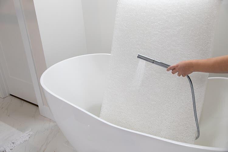 mom washing dreamweave core in bathtub