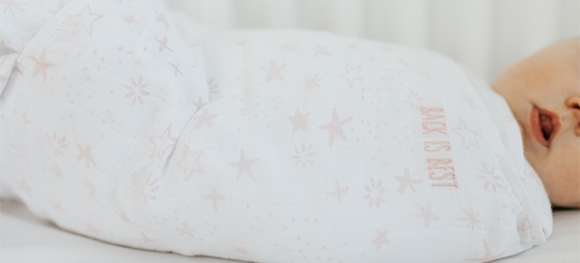 close up of back is best embroidery on halo sleepsack swaddle