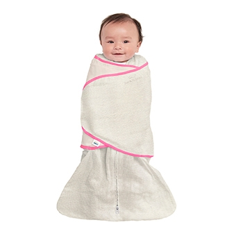 floating baby in oatmeal halo swaddle tech fabric