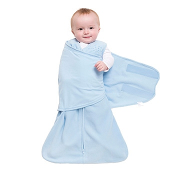 step two of wrapping baby in halo sleepsack swaddle