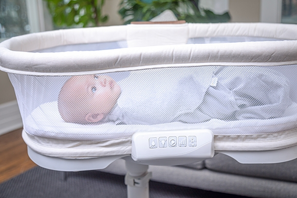 baby in halo bassinest with soothing center that has vibration
