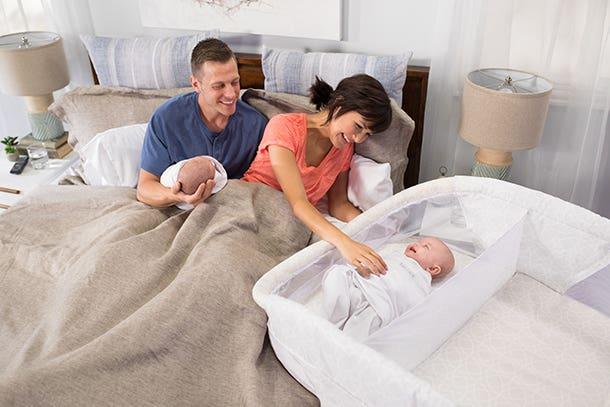 twin babies sleeping in halo bassinest twin sleeper
