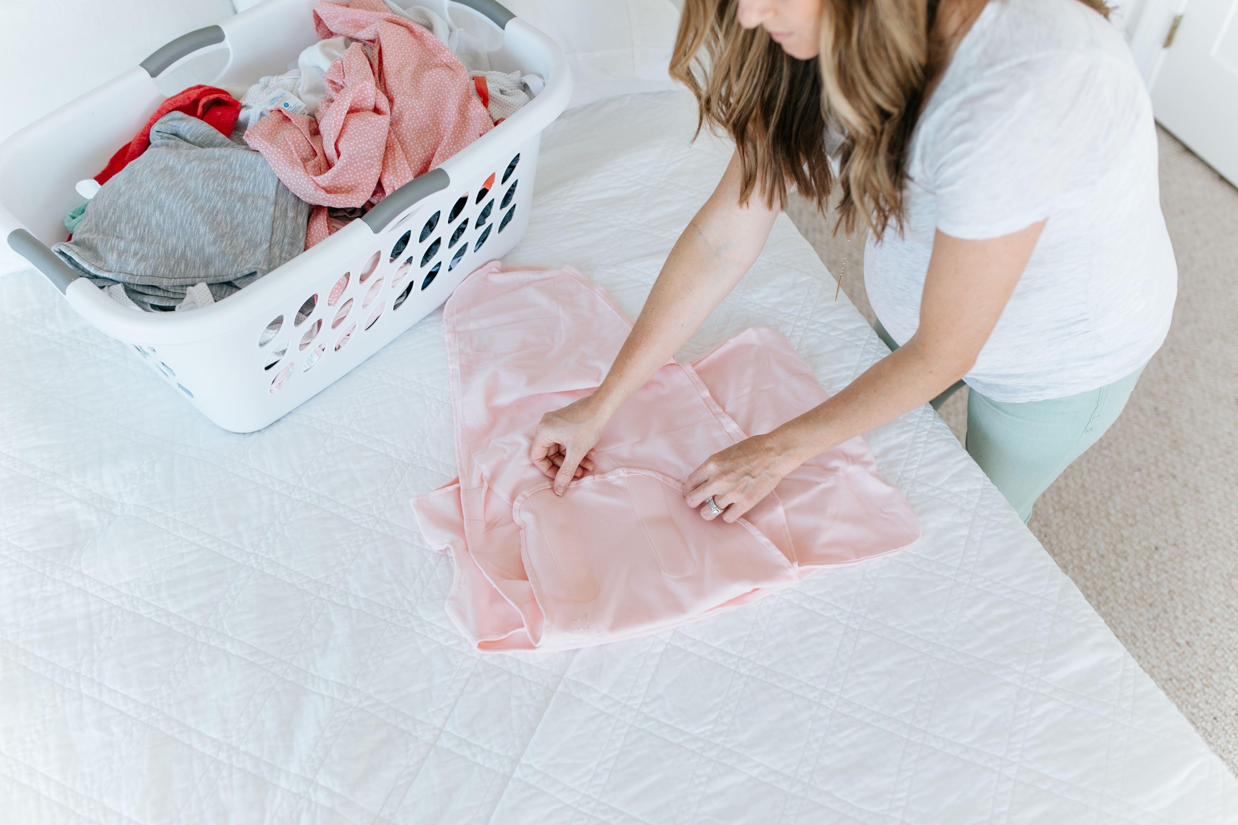 mom folding sleepsack before putting it away